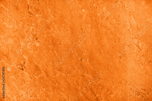Valokuvatapetti Close up of abstract turmeric orange toned granite stone texture with high resolution