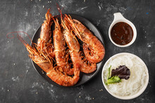 Fried Grilled Prawns With Rice Noodle, Sauce And Lettuce, Dark Background,copy Space