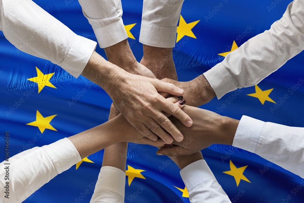 Fototapeta Multicultural hands union concept over european flag
