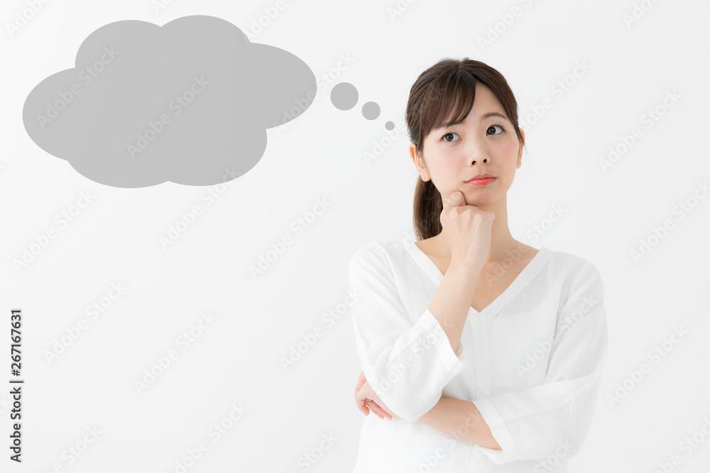 Fototapeta 考える女性