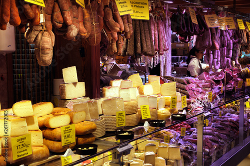 Serrano and iberian iberico ham legs, sausage, chorizo and cheese on display for Canvas