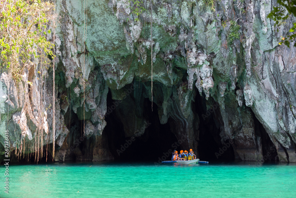 Fototapety, obrazy: Palawan, Philippines - May 3, 2019: A boat with tourists at the entrance to the underground river in Puerto Princesa Subterranean River National Park