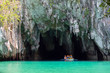 Palawan, Philippines - May 3, 2019: A boat with tourists at the entrance to the underground river in Puerto Princesa Subterranean River National Park
