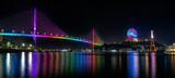 Bai Chay bridge night lights shimmering two peninsula connected Hon Gai and Bai Chay in Ha Long city, Quang Ninh province, Vietnam
