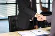 Businessmen making handshake in office business building