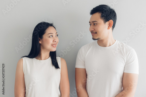 Fototapeta  Happy couple lover in white t-shirt and grey background.