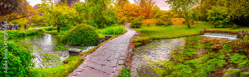 Photo sur Toile Jardin enchanted eden garden bridge over pond in horizontal panoramic Nymph Garden or Giardino della Ninfa in Lazio - Italy