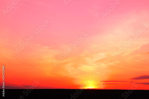 Photo Stands Candy pink Photo of beautiful bright red color-rich tropical sunset in summer in nice slightly cloudy weather with space for writing advertising text or advertising slogan for travel agency or tour operator
