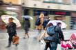 People with umbrella walking down the street on rainy day