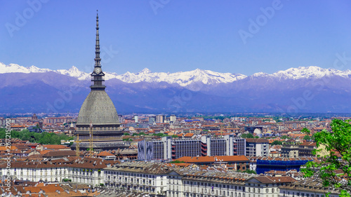 Photo  Turin, Torino, aerial timelapse skyline panorama with Mole Antonelliana, Monte dei Cappuccini and the Alps in the background