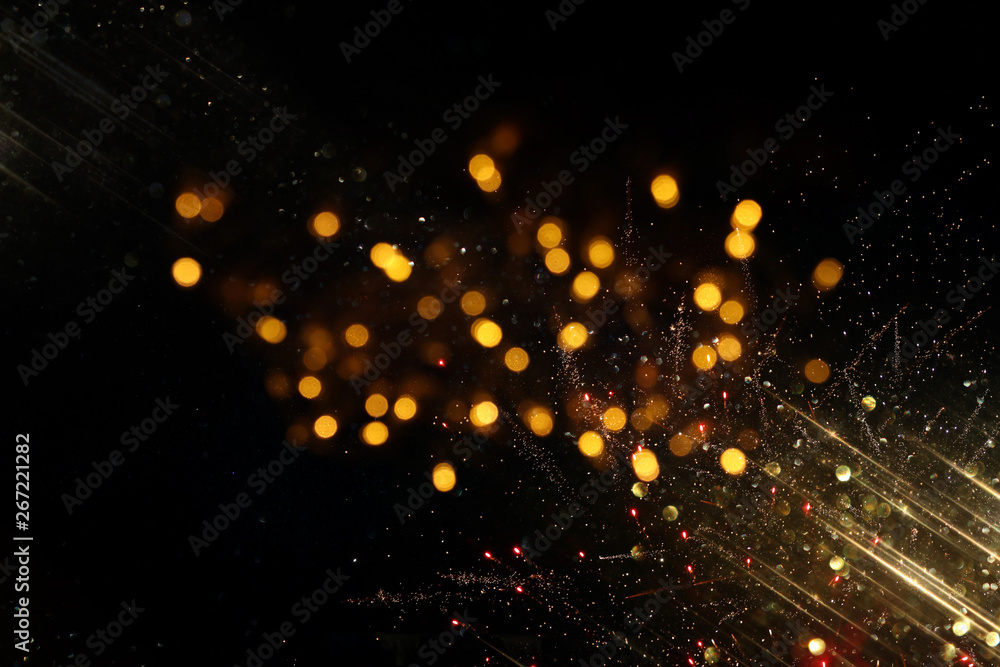 Leinwandbild Motiv - tomertu : abstract glitter lights background. black and gold. de-focused