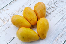 Top View Of Chok Anan Or Chocanon Mango On Wooden Background.