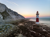 Stunning Aerial drone landscape image of lighthouse and chalk cliffs at sunrise in England - 267227632