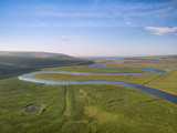 Stunning aerial drone landscape image of meandering river through marshland at sunrise - 267227858