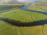 Stunning aerial drone landscape image of meandering river through marshland at sunrise - 267228091