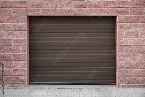 Closed roller shutter door of modern garage