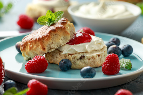 Fototapety, obrazy: Classic English scones with clotted cream, strawberries jam and other fruit