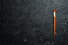 Wooden Chopsticks On A Black S...