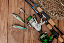 Fishing Tackle - Fishing Spinning, Hooks And Lures On Wooden Background With Copy Space