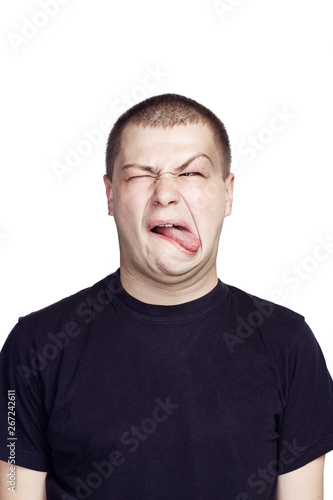 Fototapety, obrazy: Portrait of young man. Facial expression. Disgusting face.