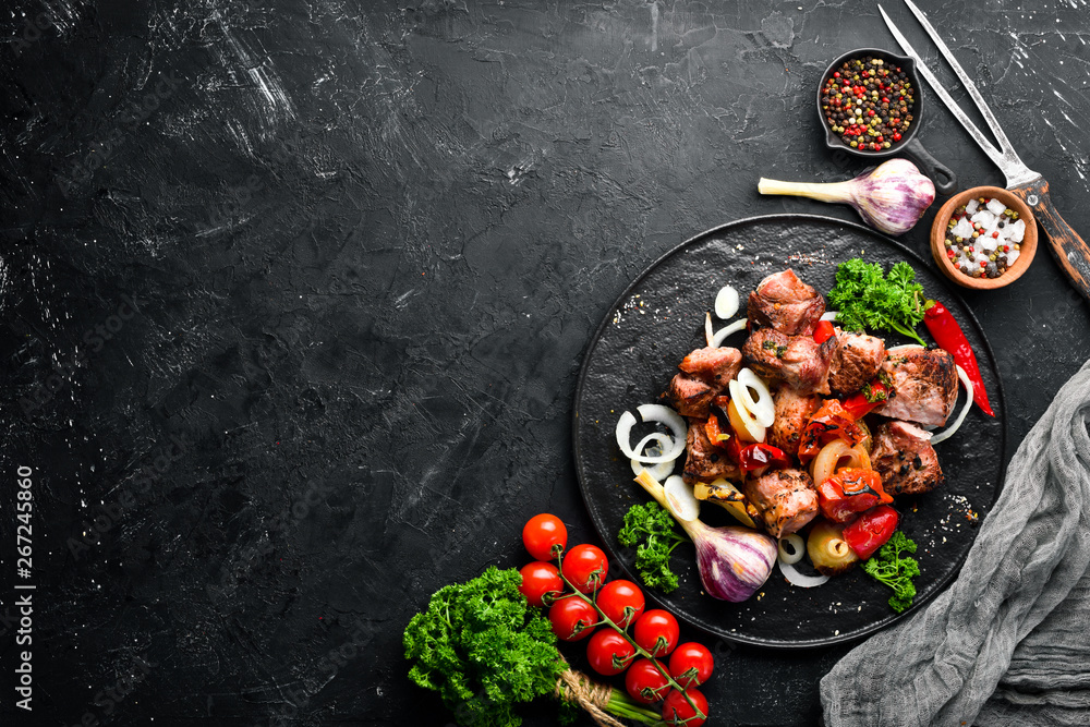 Fototapety, obrazy: Kebab in a plate. Baked meat with onions and tomatoes. Barbecue. Top view. Free space for your text. Rustic style.