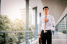 Businessman Adjusting Necktie ...