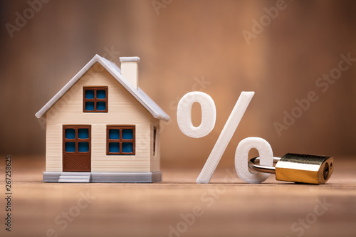 Photo  House Model Near Percentage Sign With Keypad Lock