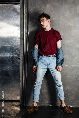 Full Length Portrait Of Stylish Young Fashion Model Man In Bright Red Sunglasses And Denim Casual