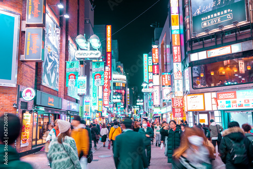Photo Stands Tokyo TOKYO,JAPAN - February 22, 2019 : Blurred people walking in Shibuya street , Japan