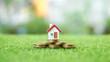 Leinwanddruck Bild - Home on the top of pyramid coin. Home loan.