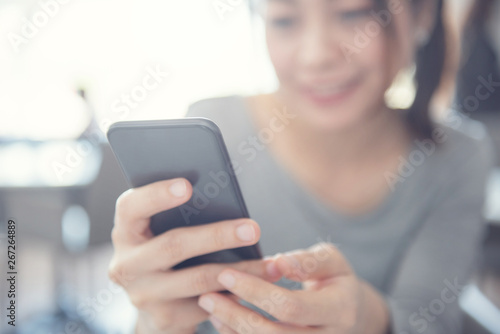 Foto  Close up of happy woman using mobile phone.
