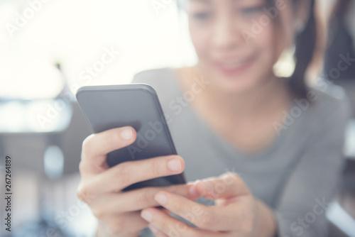 Fotografía  Close up of happy woman using mobile phone.