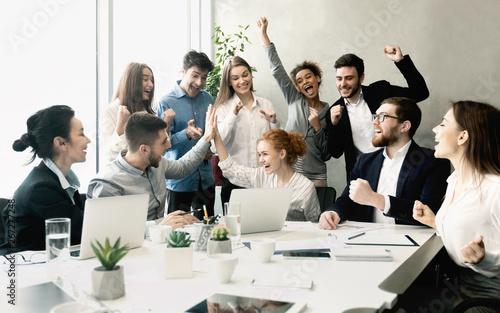 canvas print motiv - Prostock-studio : Business team celebrating success together on workplace