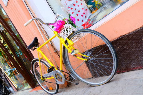 Fotobehang Fiets Vintage yellow bicycle parked on the street
