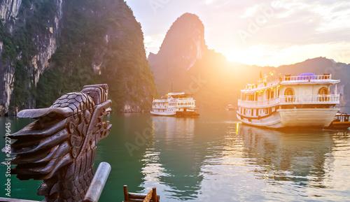 Leinwand Poster  Cruise sun ship wooden junk sailing Ha Long Bay, Dragon Vietnam UNESCO World Heritage Site