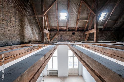 Obraz na plátně floor beams in attic / loft during renovation,  roof under construction