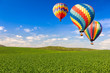 canvas print picture - Hot Air Balloons Over Lush Green Landscape and Blue Sky
