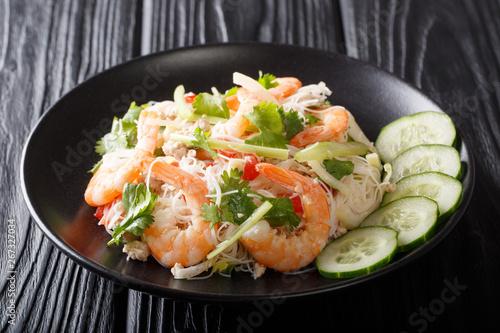 Fototapeta Thai recipe Yum Woon Sen salad with shrimp, pork and vegetables closeup on a plate. horizontal obraz