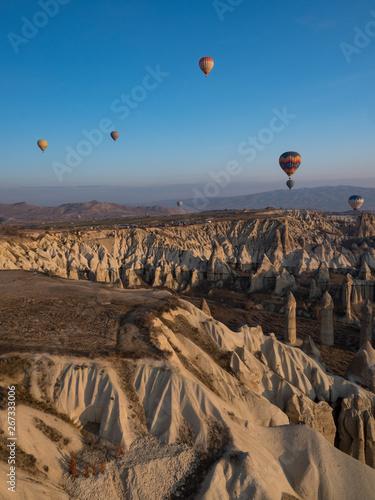 Turkey - February, 2019: Magnificent dawn with hot air balloons. Cappadocia, Goreme