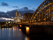 December, 2018: Night view of Hohenzollern Bridge and the cathedral in Cologne, Germany