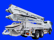 canvas print picture - Image of a concrete pump. Concrete pump on the cargo chassis. Isolated on blue.