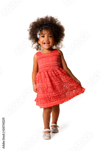 Full length portrait of cheerful african american little girl, isolated Wall mural