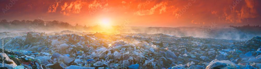 Fototapeta Sunrise Sun above the ocean of garbage