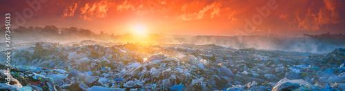 Foto auf Leinwand Rotglühen Sunrise Sun above the ocean of garbage