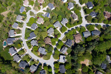 Upper Middle Class American Neighborhood With Curving Street In Maryland