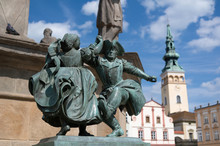 Statue Of Dancers, Novy Jicin, Czech Republic / Czechia - Small Bronze Monument  And Town Hall In The Background. Very Low Depth Of Field