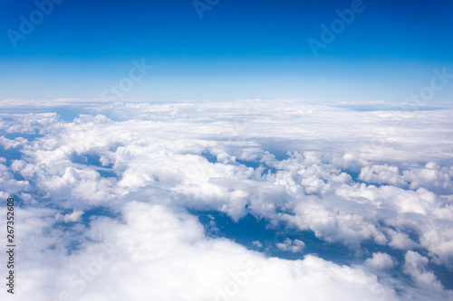 obraz lub plakat Earth in the airplane window with clouds