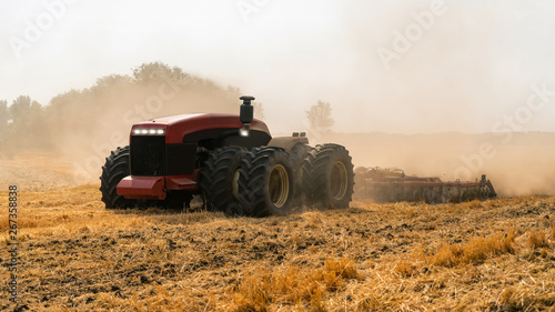 Fototapeta Autonomous tractor working on the field. Smart farming	 obraz