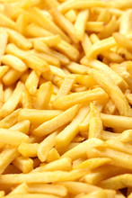 Heap Of French Fries As Textured Background