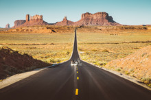 Motorcycle On Monument Valley Road At Sunset, USA